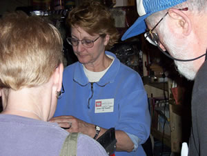 Joanne demonstrates the Strauch Carder at Maryland Sheep and Wool Festival