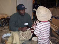 Robert Watson explains white oak basketry to a young child.